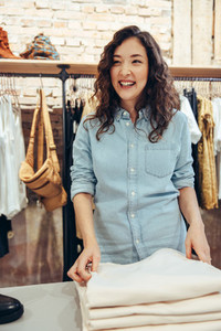 Smiling shopper in fashion store