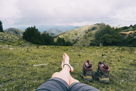 bare feet resting after climbing a mountain