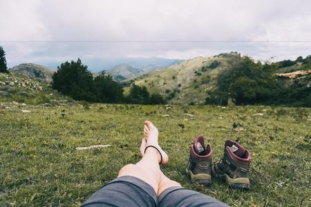 bare feet resting after climbing a mountain