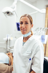 Portrait of confident dental expert