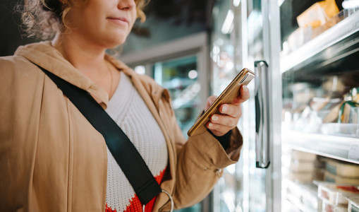 Shopper looking at the grocery list on her phone