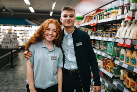 Two supermarket workers