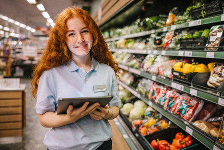 Young worker working in a supermarket