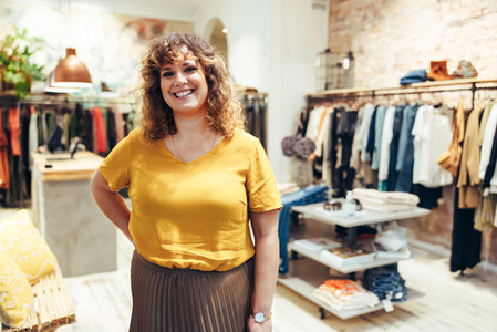 Portrait of female fashion store owner