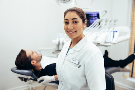 Confident female dentist in her clinic