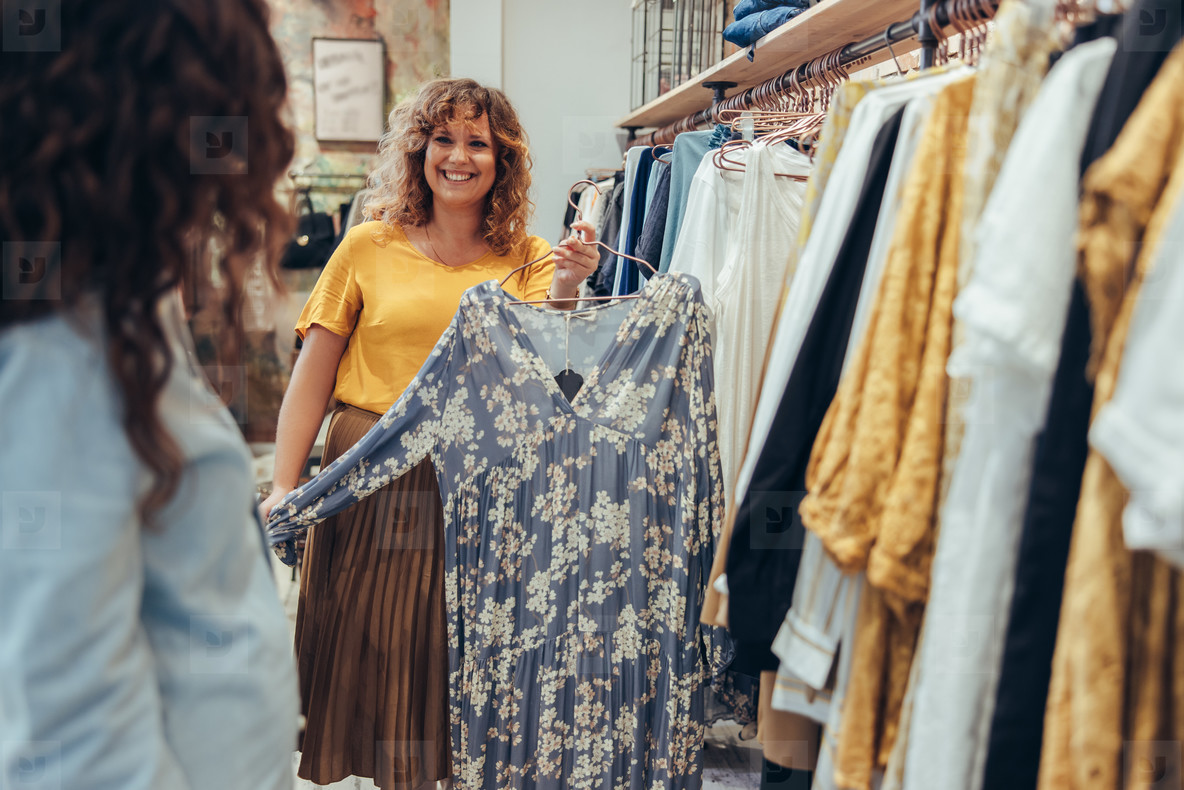 Clothing store owner helping a customer