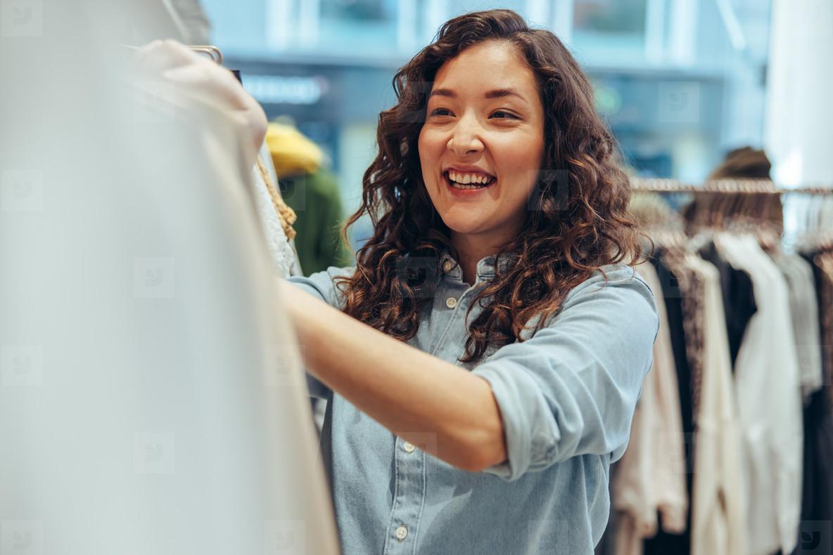 Woman enjoying clothes shopping