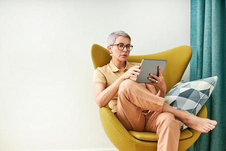 Stylish senior woman sitting