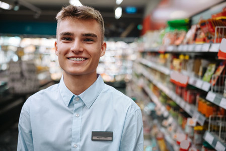 Happy young supermarket worker