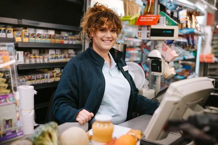Woman cashier at supermarket