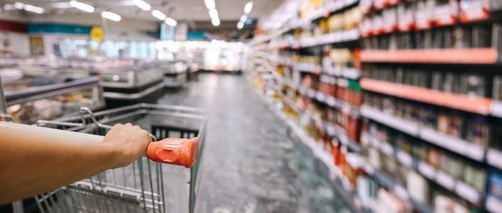 Closeup of customer with shopping cart