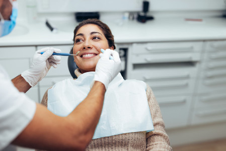 Woman getting a dental treatment at dentistry