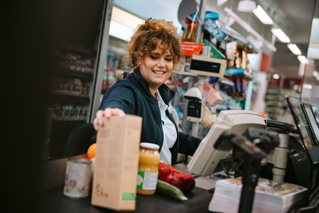 Woman working in modern supermarket