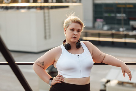 Portrait of a confident plus size woman standing on a roof