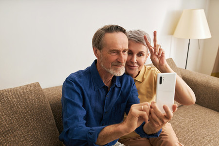 Senior couple taking a selfie  Mature people spending time together and having fun