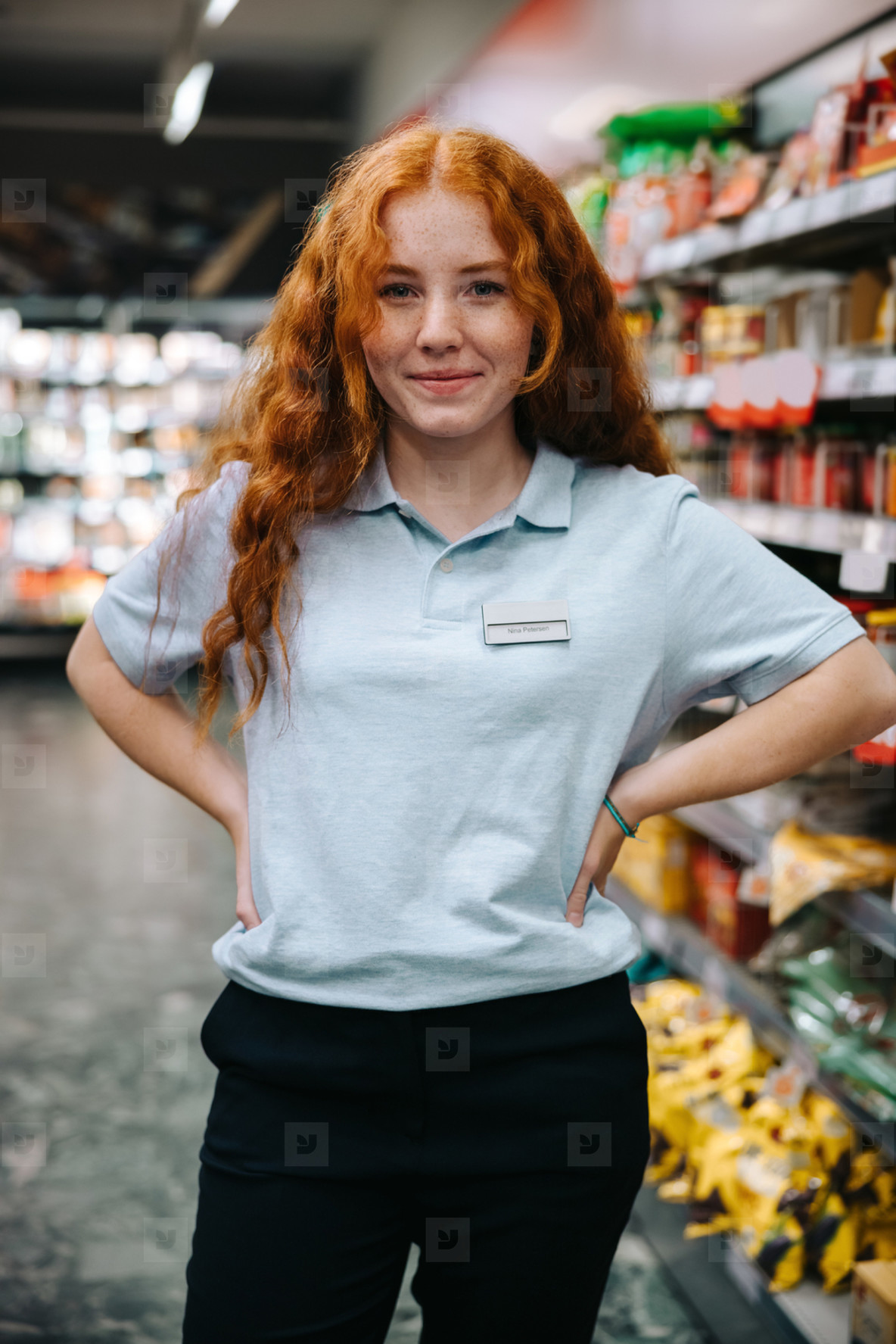 Young worker at supermarket