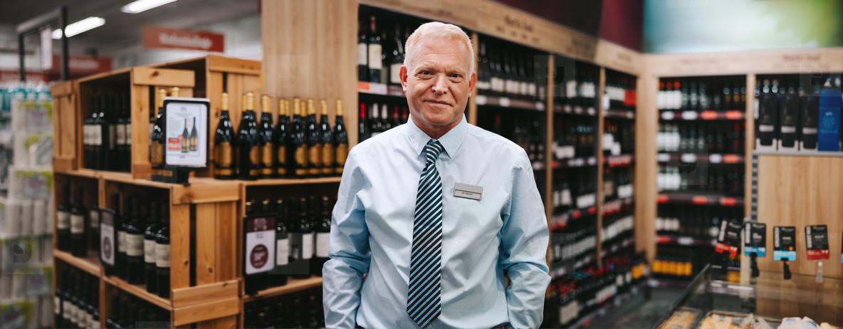 Portrait of a liquor store manager