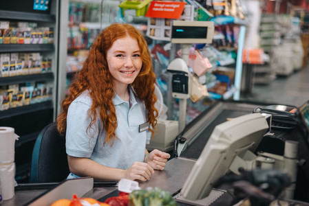 Young supermarket cashier