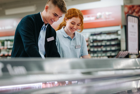 Trainee workers working together in supermarket