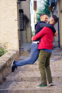 Gay couple in a fun and romantic moment in the street