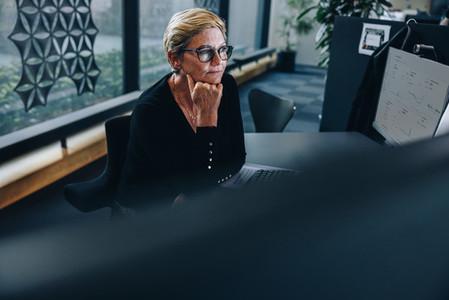 Thoughtful senior businesswoman at her desk