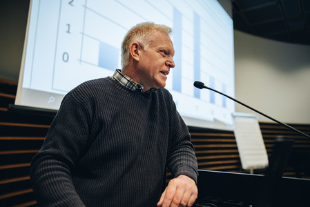 Senior businessman giving presentation during a seminar