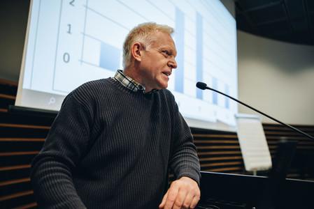 Senior businessman giving presentation during a seminar