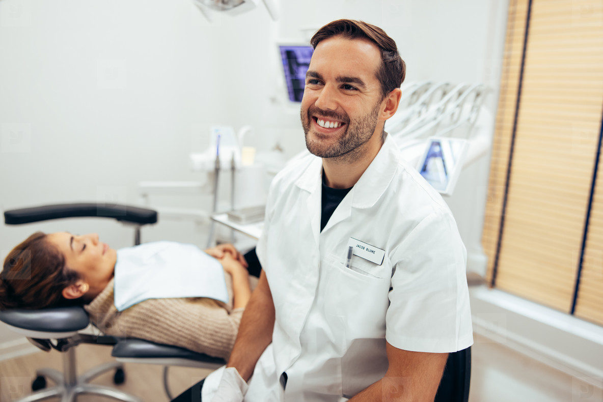 Dentist in dental office with patient for treatment