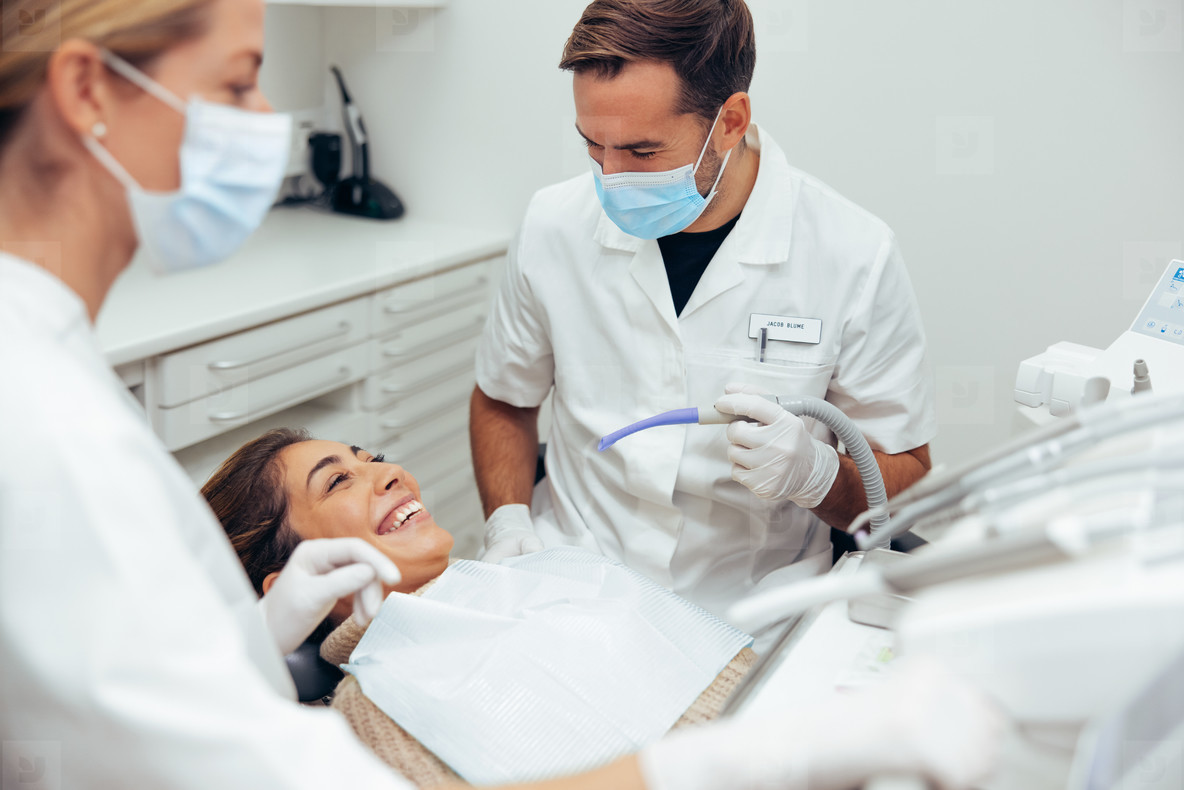 Woman smiling during her dental treatment
