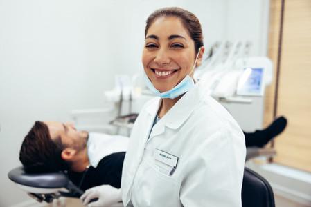 Smiling female dentist in dental hospital