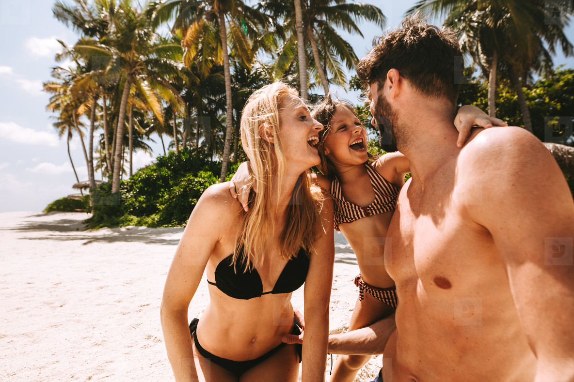 Happy family vacation at a tropical beach