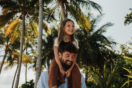 Father and daughter on a tropical holiday