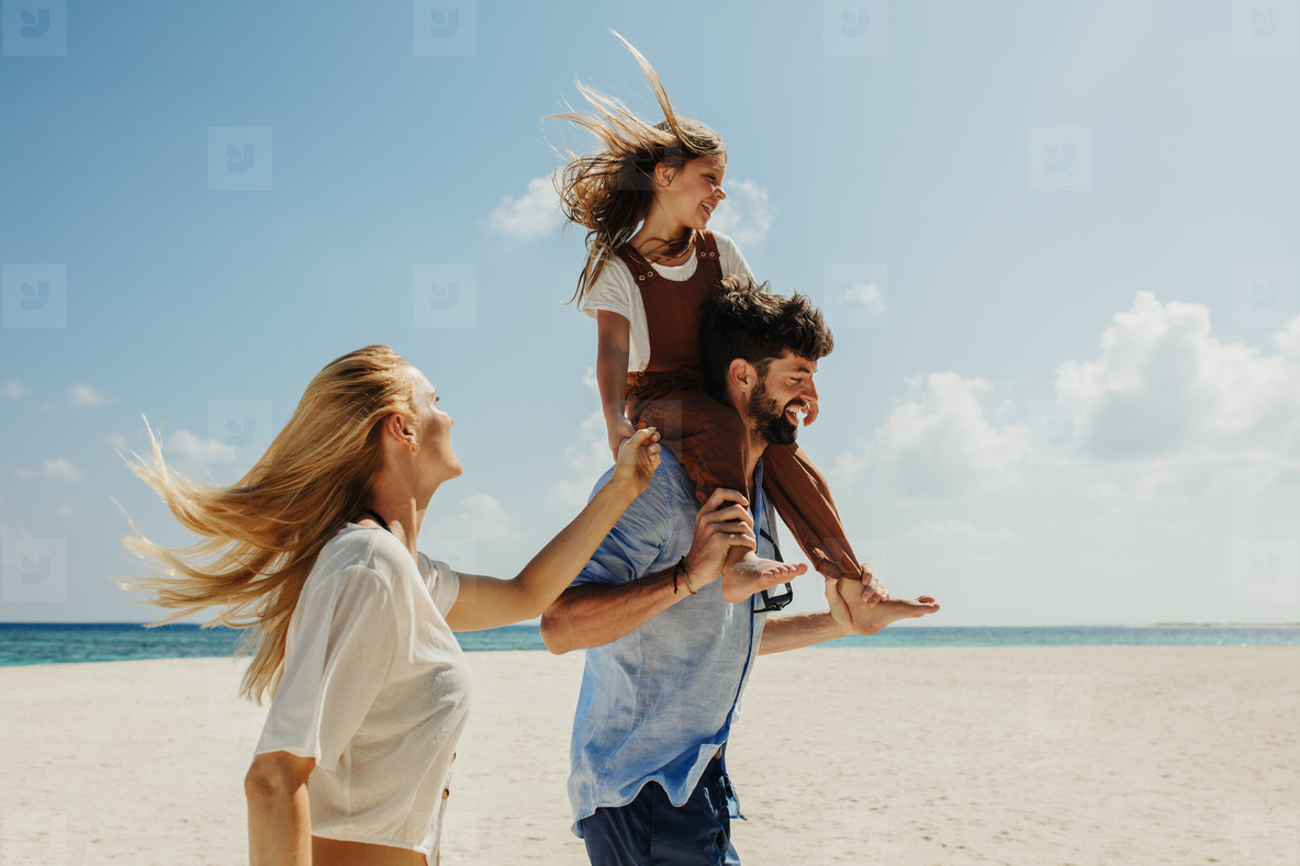 Couple with kid on a beach vacation