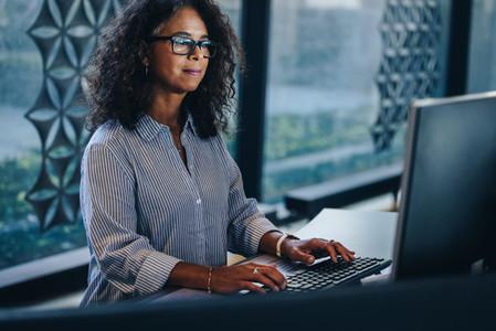 Mature businesswoman working at her office desk