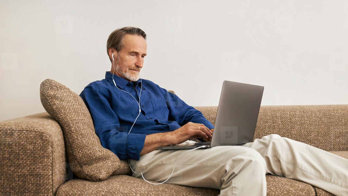 Senior man lying on a couch