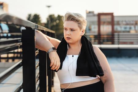 Curvy woman leaning on a railing
