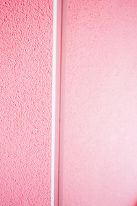 Minimal details in white in a pink room