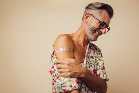Mature man feeling relaxed after getting vaccine