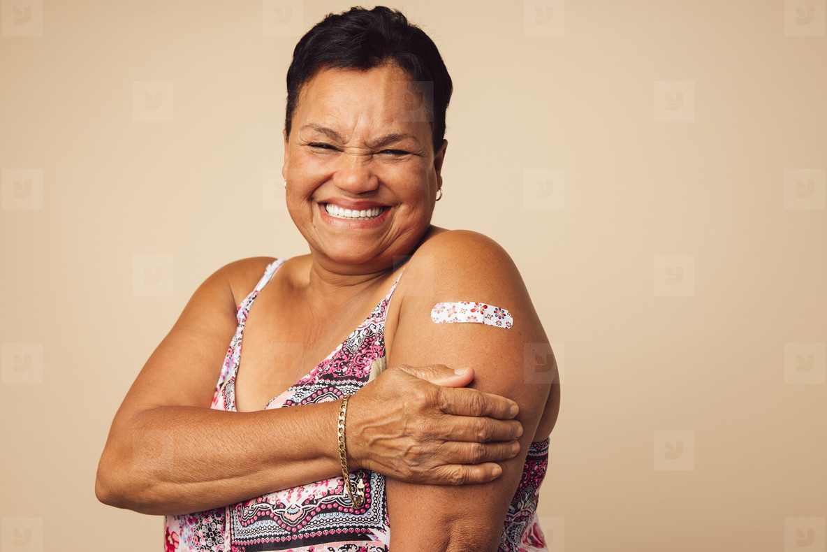 Senior woman smiling after vaccination