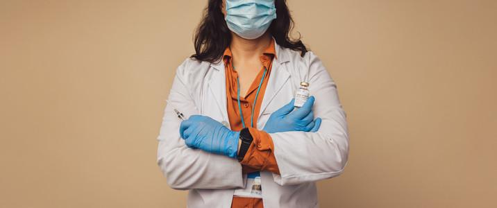 Doctor with a syringe and coronavirus vaccine