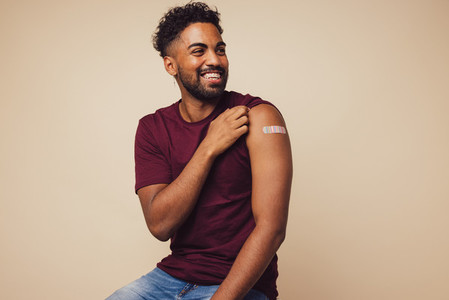 Man smiling after receiving vaccination