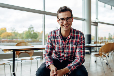 Young business professional smiling at camera