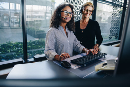 Two business professionals working together in office