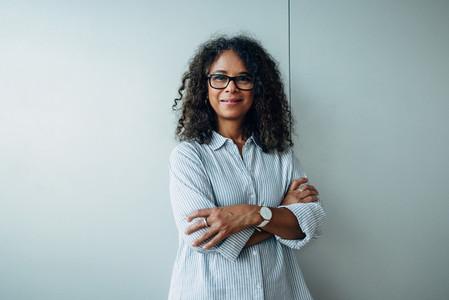 Confident mature businesswoman in office