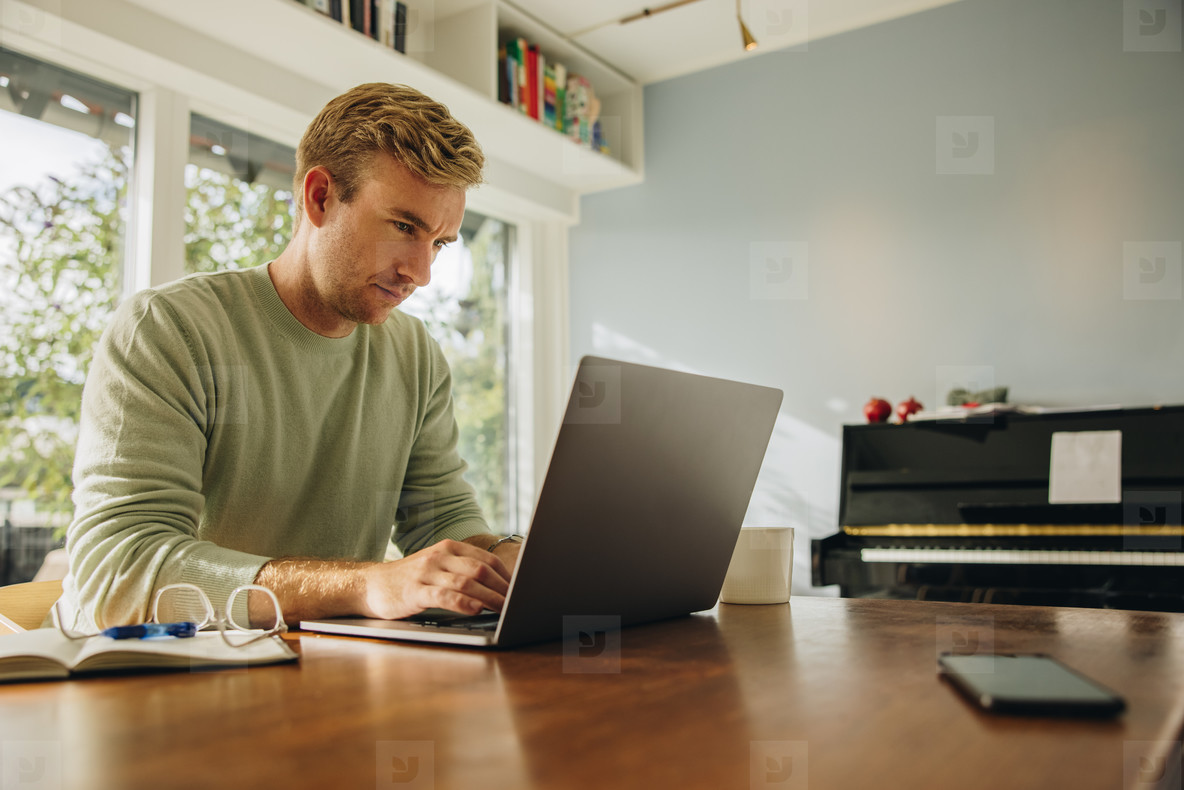 Man at home working on laptop