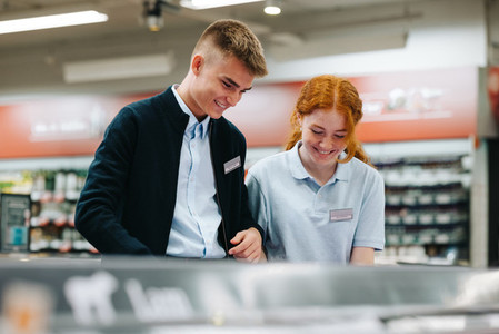 Trainees working together in grocery store