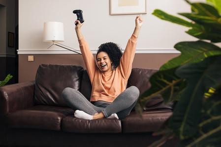 Happy mixed race woman sitting