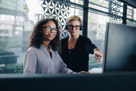 Businesswomen cooperating working in a call center