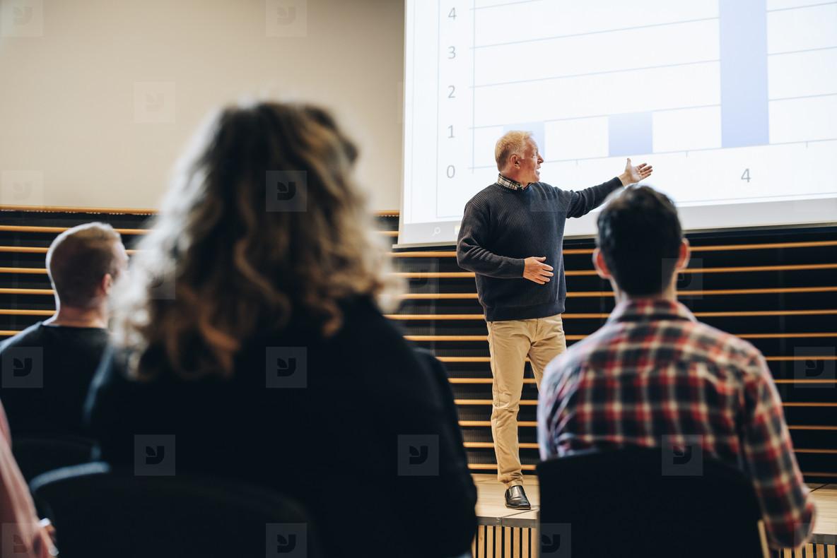 Senior businessman giving presentation in a summit