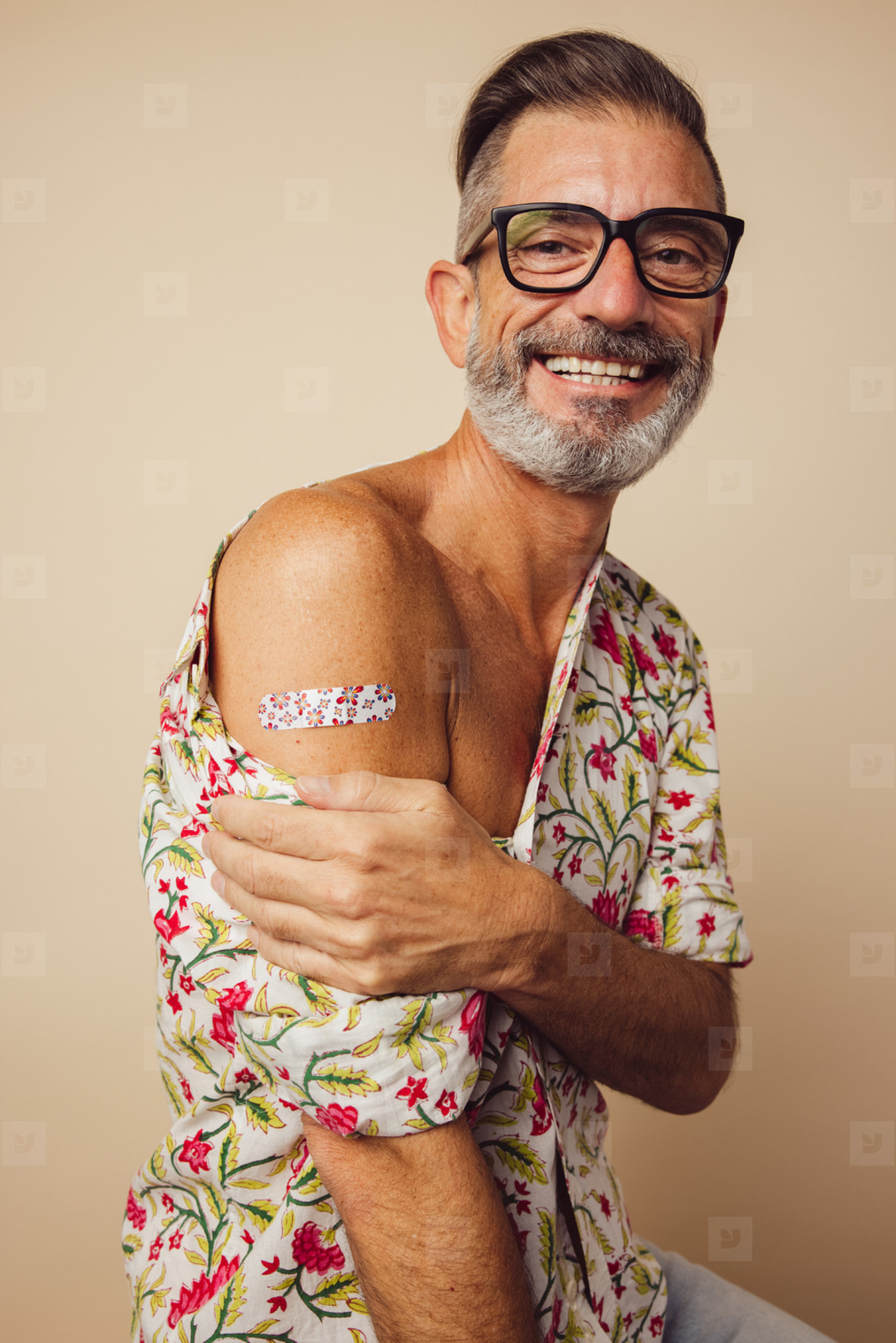 Mature man smiling after getting vaccine